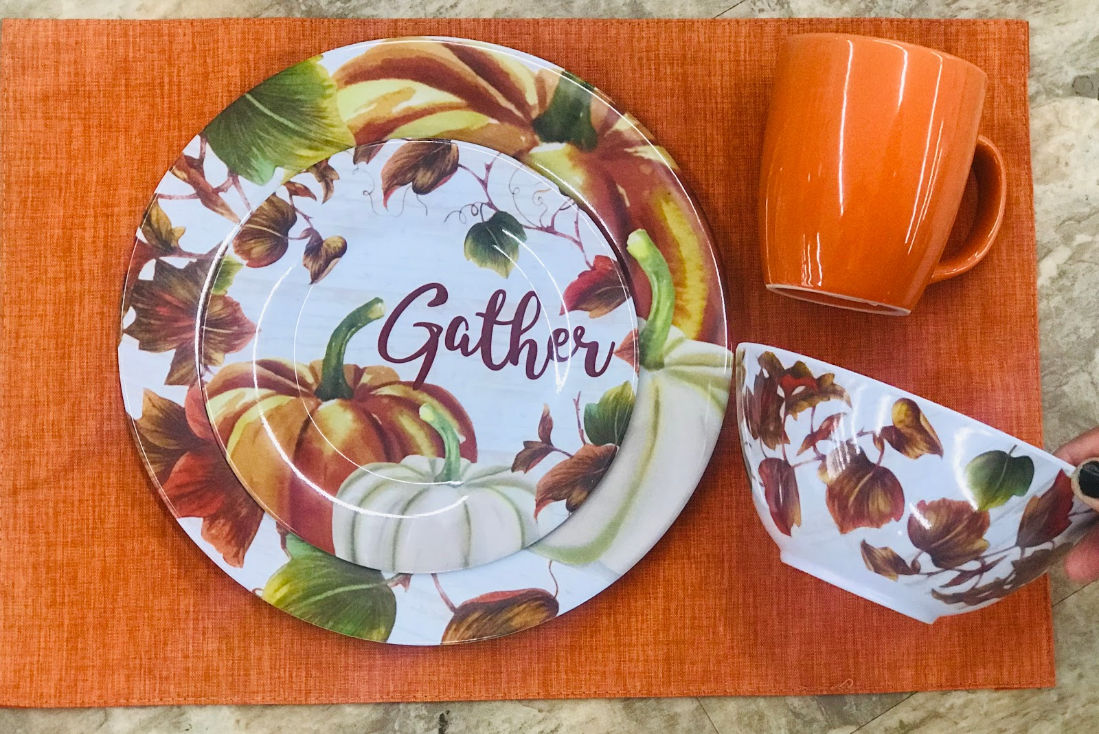 Image:The third style with the orange placemats may be the winner. Since Rico nor myself could choose, we got both the orange and green ones. The orange will be for Fall, and the green will be for Xmas. Yes, I purchased both because the dollar stuff goes fast.