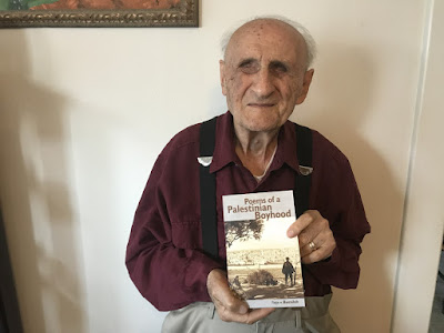 Reja-e Busailah with his latest publication Poems of a Palestinian Boyhood.