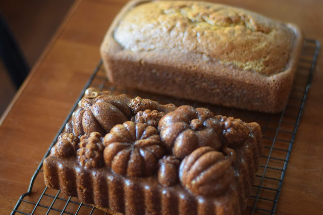 The loaves of pumpkin bread, removed from the pan, on a cooling rack.