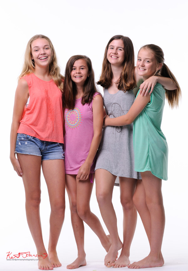 Group shot of four girls, studio white background for a Tween to Teen Fashion - Look-book & Branding Photography