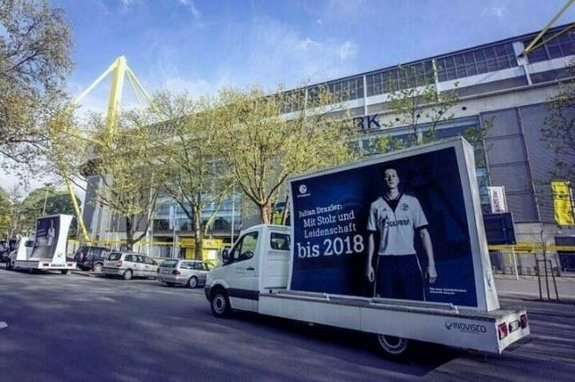 Schalke's trucks drive past Borussia Dortmund's Signal Iduna Park Stadium