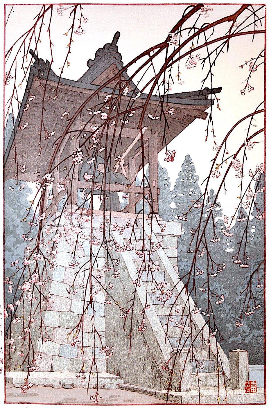 Toshi Yoshida, a monk strinking a bell among blossoms