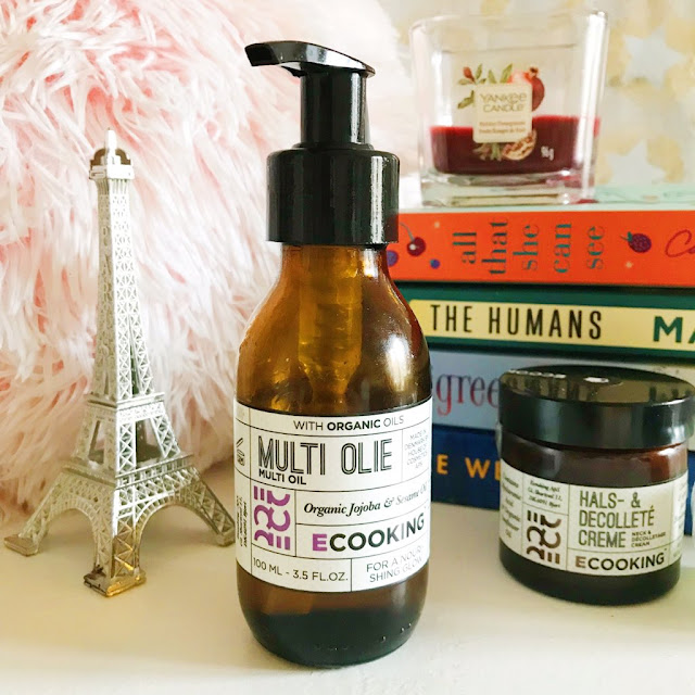 ECooking Skincare Multi Oil placed in front of stack of books, fluffy pillow and Paris ornament