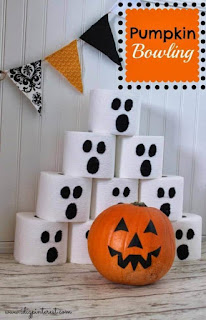 Playing Halloween bowling with pumpkins is a great family Halloween activity.