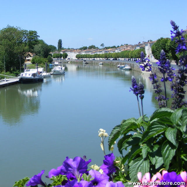 Quay on the Charente, Saint Savinien. Charente-Maritime. France. Photographed by Susan Walter. Tour the Loire Valley with a classic car and a private guide.