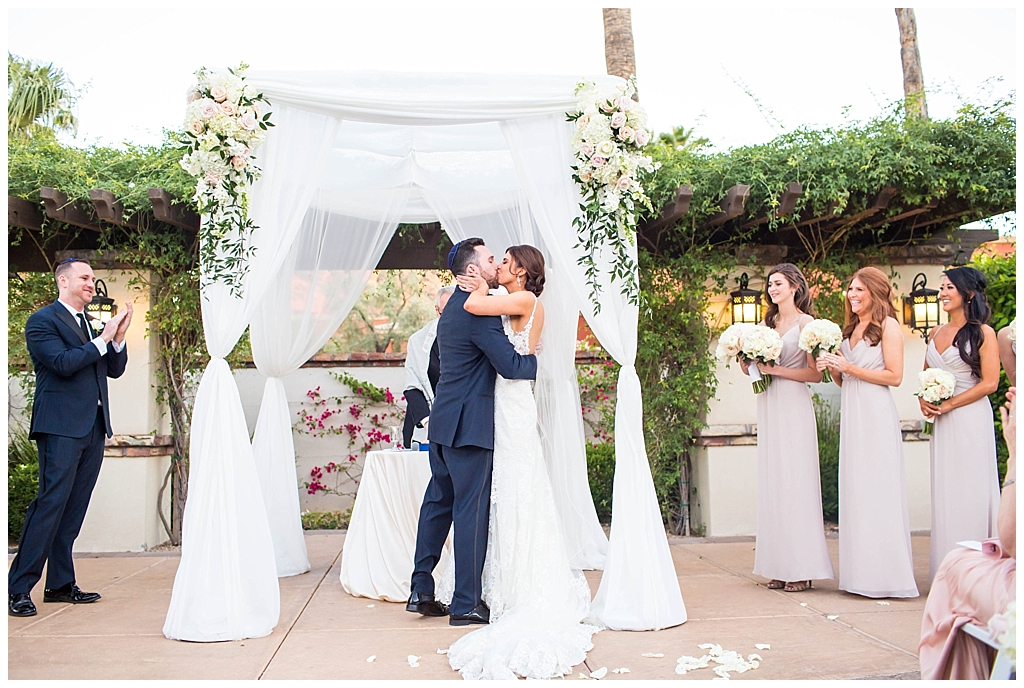 bride and groom announced husband and wife first kiss at Omni Montelucia wedding