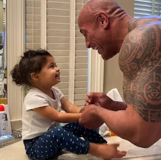 Curtis Bowles' step-sibling The Rock with his daughter