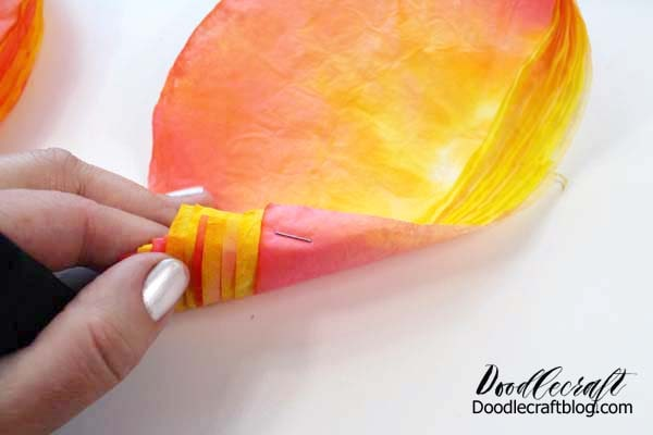 How to make a rose out of coffee filters dyed with food coloring.