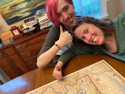 Photo of me and Katie giving thumbs ups near a finished puzzle.