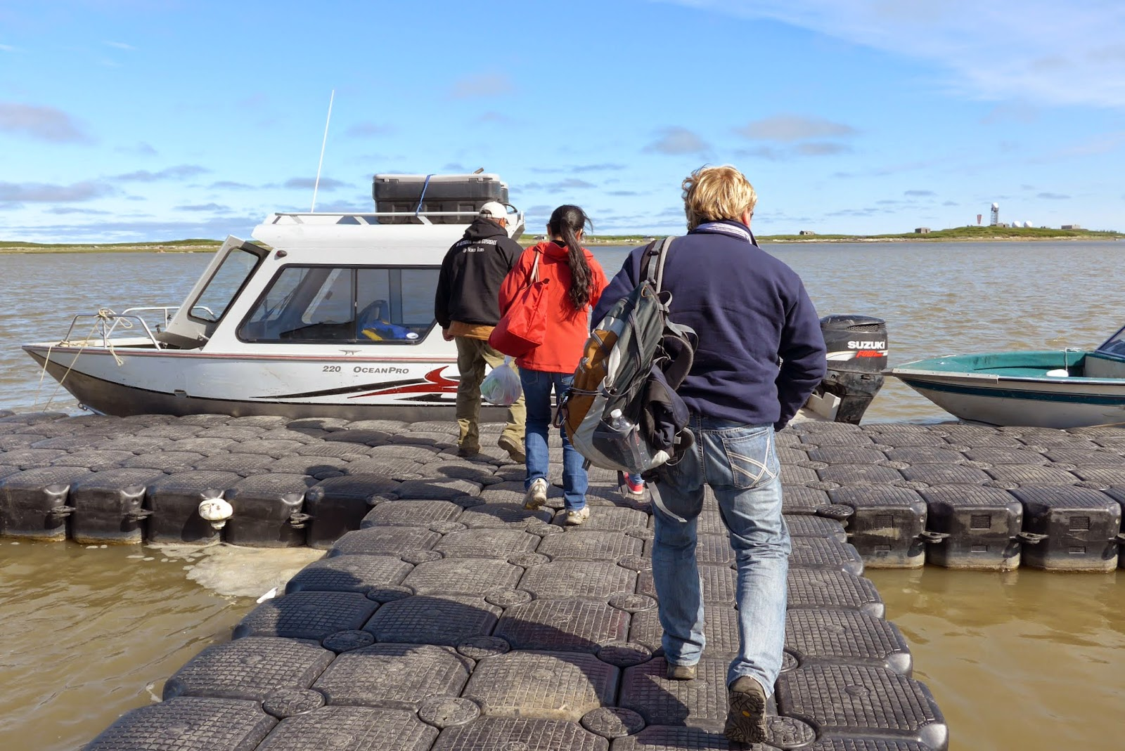 Boarding the boat in Tuktoyaktuk.