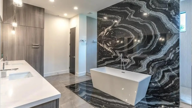 the use of an accent stone in a modern bathroom