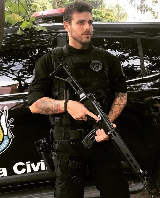 handsome-jesus-looking-bearded-man-black-policeman-uniform-armed-rarroo-hunk
