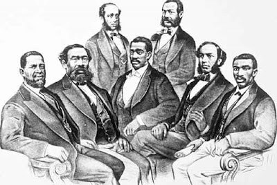 These are the first blacks elected to U.S. Congress. In the front row: Hiram R. Revels (First Black Senator), Benjamin S. Turner, Josiah T. Walls, Joseph H. Rainey, and Robert B. Elliot; back row: Robert D. De Large and Jefferson Long