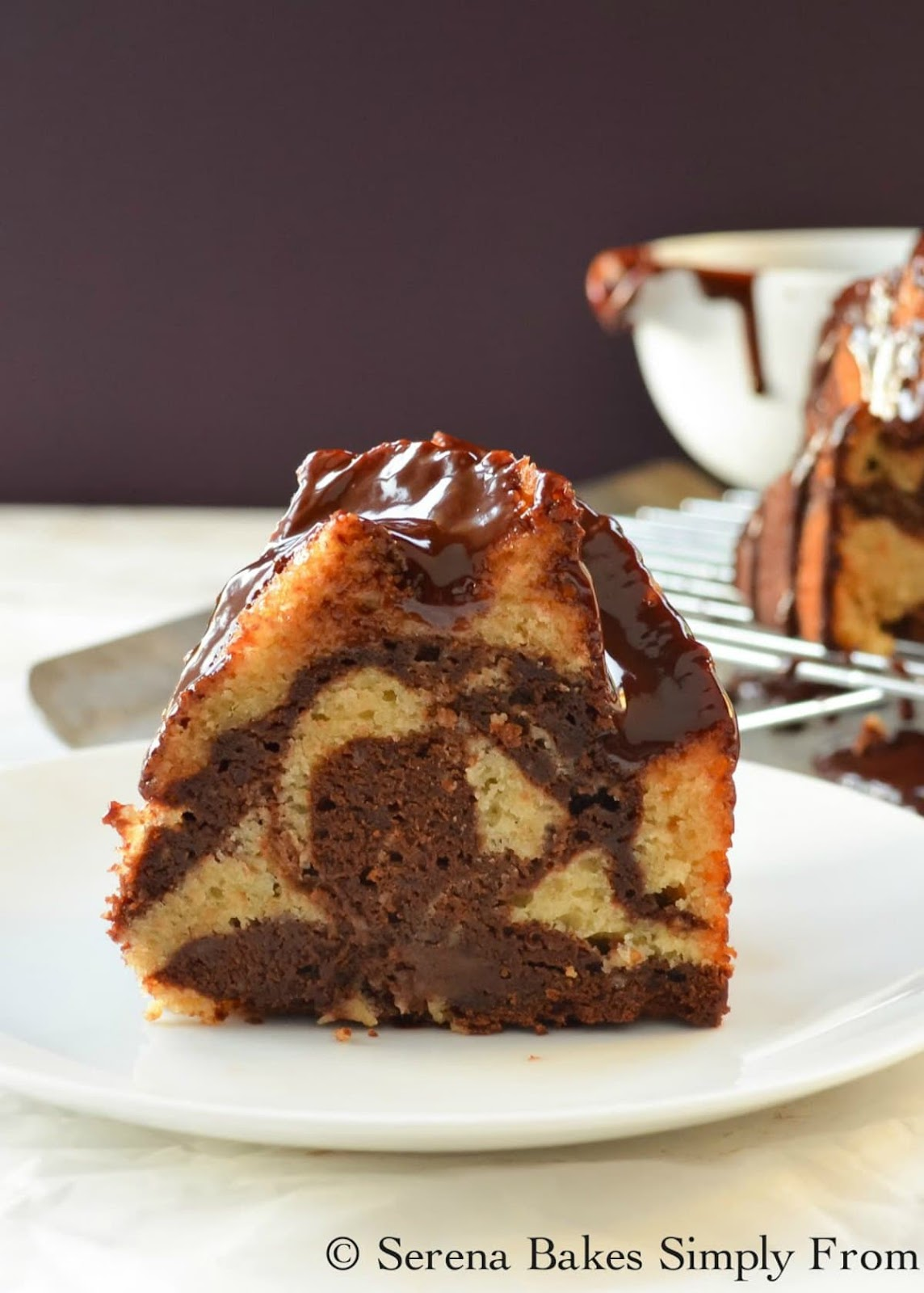 Buttermilk Marble Bundt Cake Recipe with a glossy chocolate glaze. A favorite delicious dessert recipe from Serena Bakes Simply From Scratch.