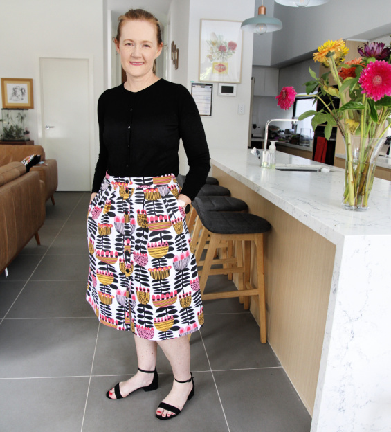 woman posing in a bright floral skirt