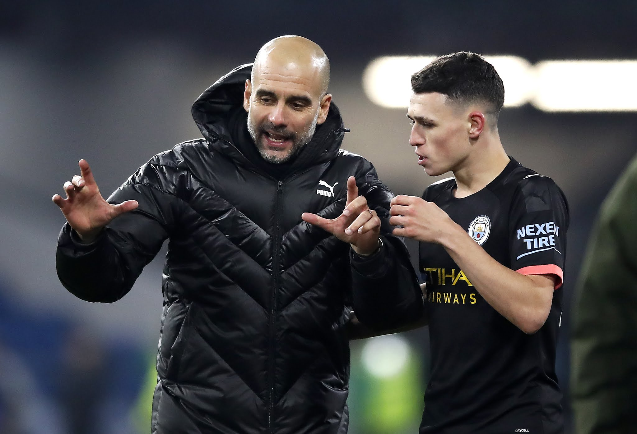 Pep Guardiola and Phil Foden
