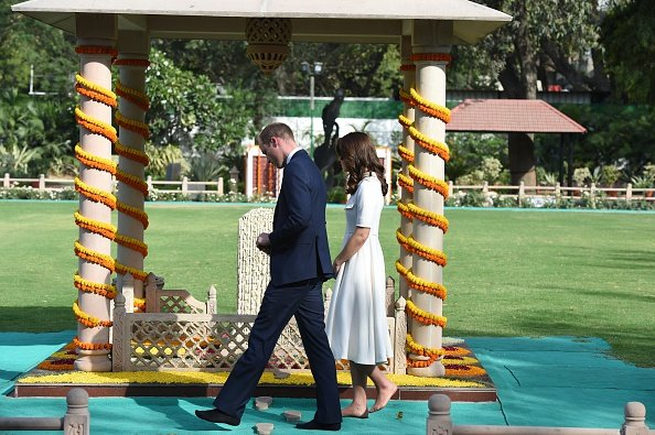 Britain's Prince William, Duke of Cambridge and his wife Catherine, Duchess of Cambridge pay tribute during a visit to Gandhi Smiriti, an Indian museum