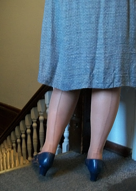 vintage seamed stockings and 1940's dress in an old asylum