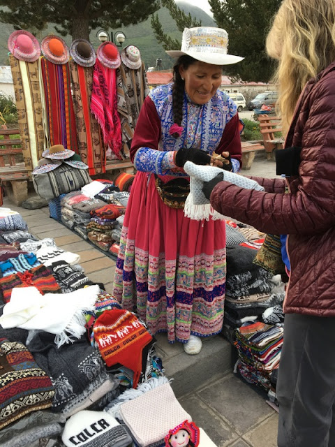 woman selling handicrafts in the Maca town square, Peru