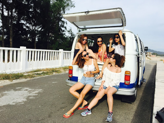 https://www.pexels.com/photo/photo-of-five-women-sitting-in-back-of-van-2101538/