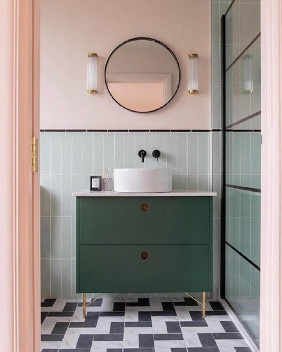 Colorful bathroom with retro style decorated with round mirror