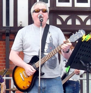 Ian Cawsey of The Moggies band performing in Brigg town centre