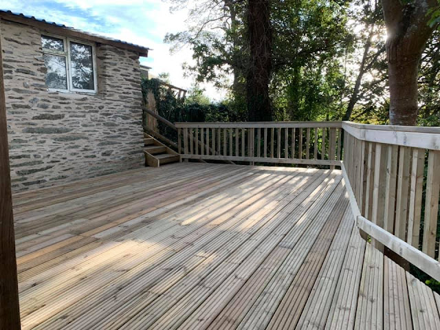 Sloping garden deck