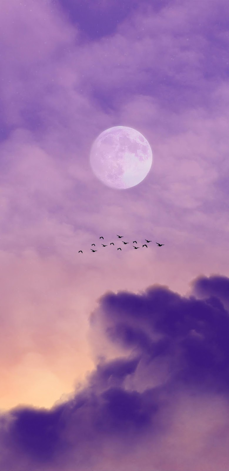 Full moon in the twilight sky