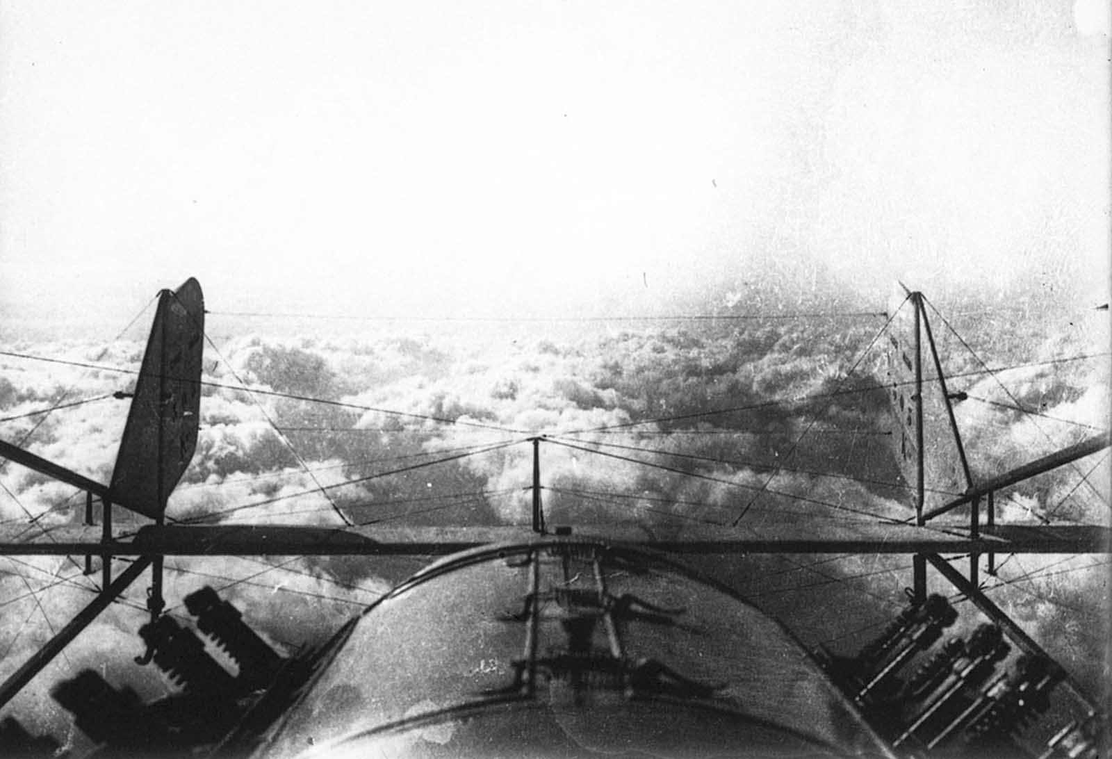 Returning from a reconnaissance flight during World War I, a view of the clouds from above.
