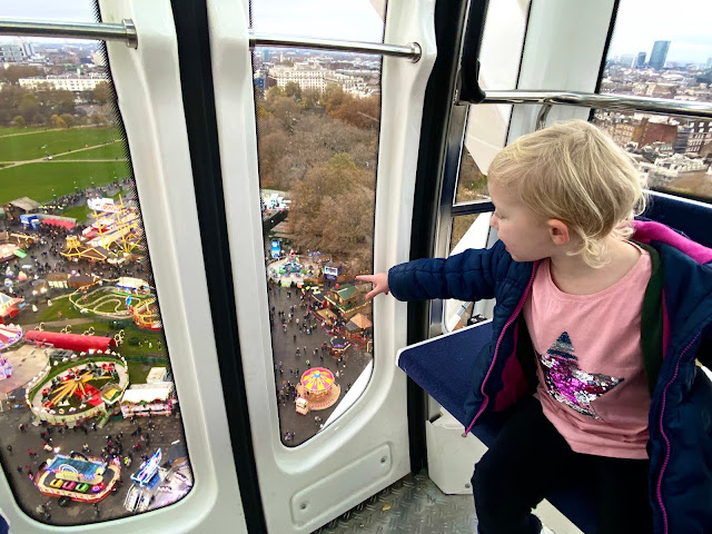 A child in a pod on the giant wheel at Hyde Park's Winter Wonderland