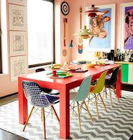 Lovely pop color dining room design features peach pink walls
