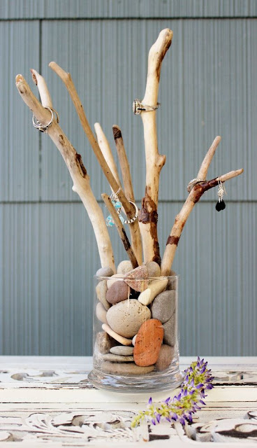 A tree branch-style jewelry display.