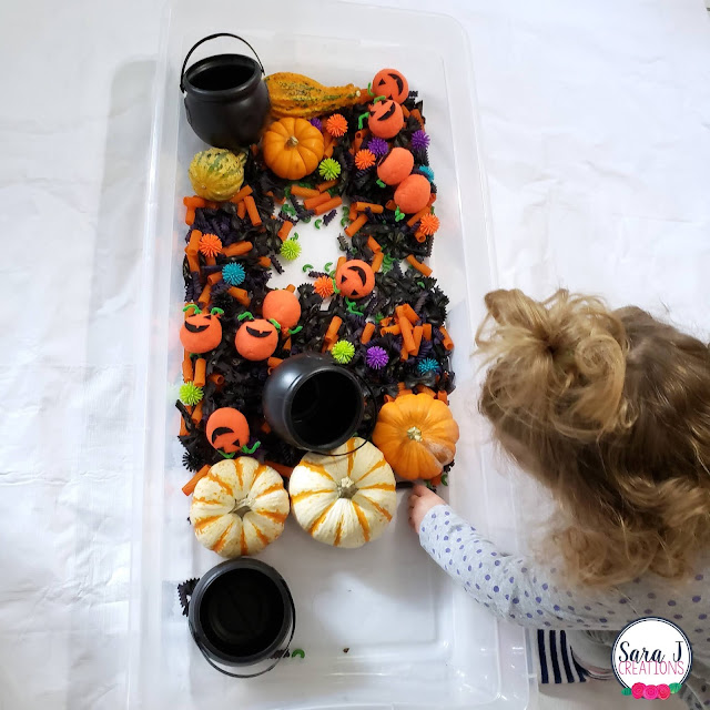 Halloween sensory bin with dry noodles