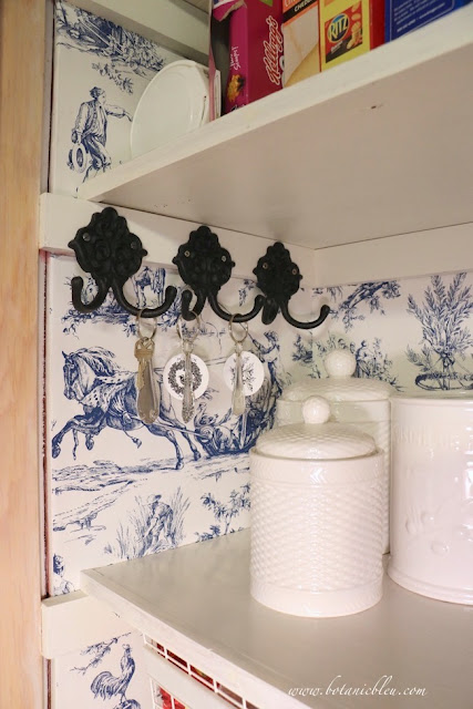 Toile pantry update with  black iron double hooks for keys