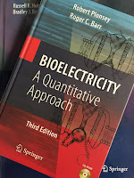 Bioelectricity: A Quantitative Approach, by Plonsey and Barr, superimposed on Intermediate Physics for Medicine and Biology.