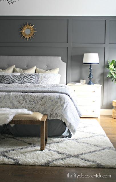 dark wall behind bed