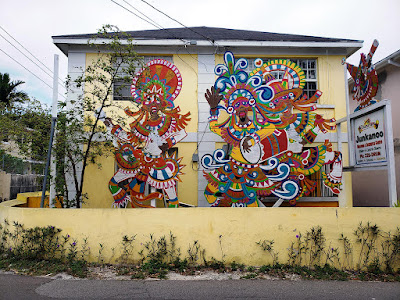 2 storey building with painted junkanooers