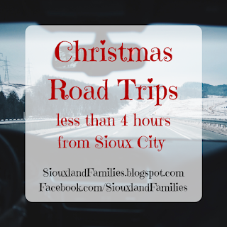 "in background, a snowy winter scene surrounds a highway as seen from inside the front seat of a car. foreground reads ""Christmas Road Trips Less than 4 Hours From Sioux City"""
