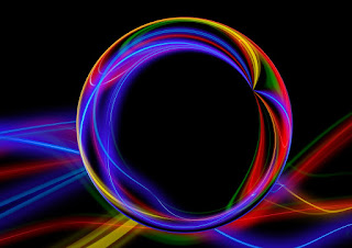 An image of coloured bars of light, with a transparent sphere in the foreground seemingly refracting the image of the lights such that the space seen through the centre of the sphere is apparently empty.