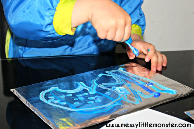Painting on foil using q tips - simple art ideas for kids.