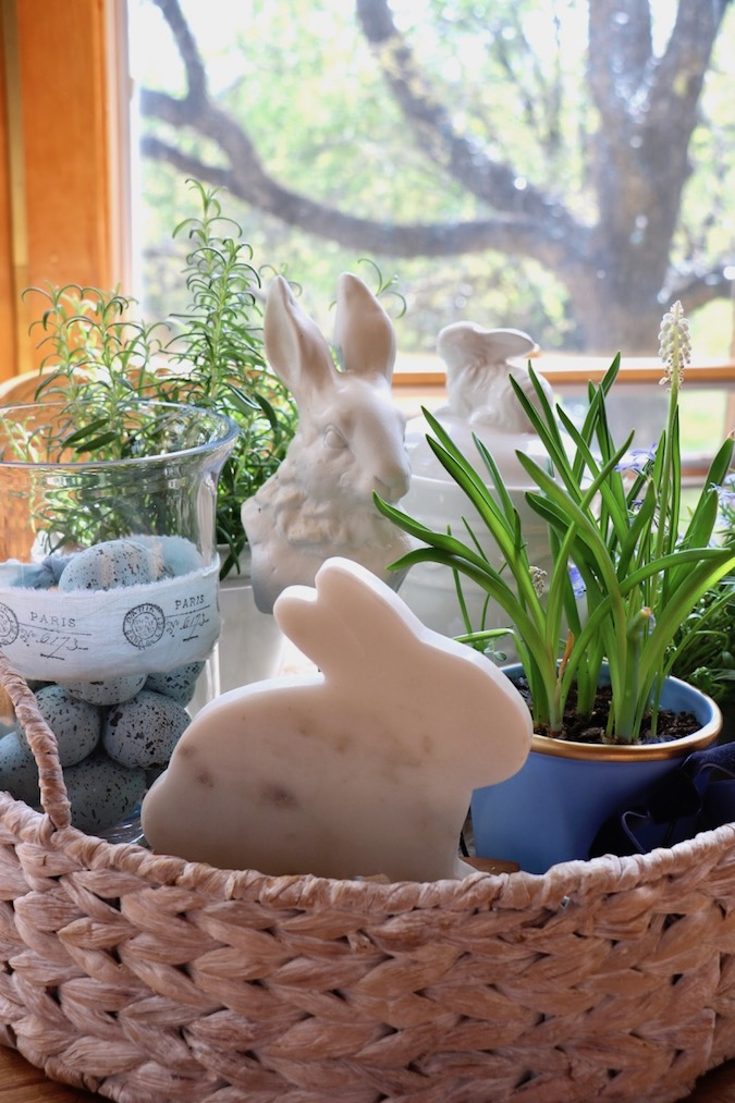 Three white bunnies are adorable as part of a Spring Blue and White Basket Arrangement