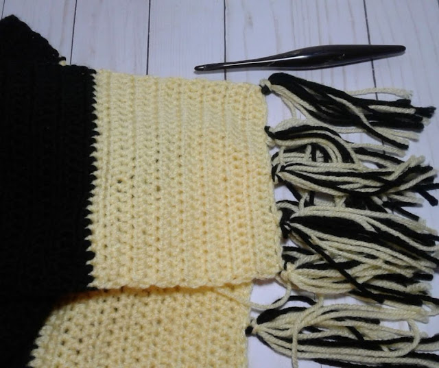 yellow and black scarf with a furls crochet hook