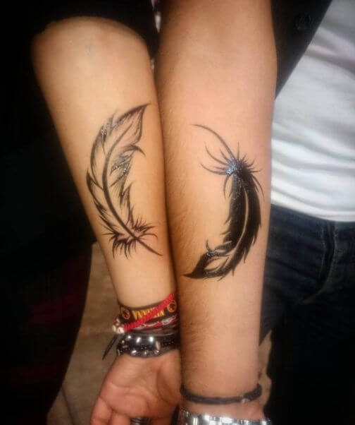 Matching feather Tattoos