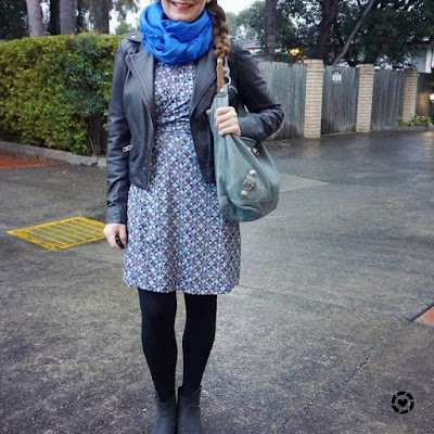 Awayfromtheblue instagram | blue snood, printed wrap dress, Balenciaga day bag and leather jacket winter outfit