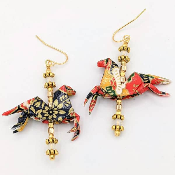 pair of patterned paper origami horse earrings with bead accents