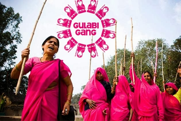 Sampat Pal Devi and the real Gulabi Gang protesting with sticks at Delhi High Court in pink saris