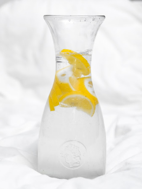 Clear glass water bottle infused with fruit