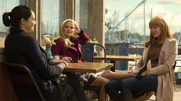 screen cap from Big Little Lies of Shailene Woodley, Reese Witherspoon, and Nicole Kidman sitting around an outdoor table at a cafe