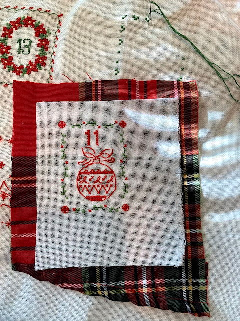 This is a part of the tablecloth that I am thinking of using to finish these.