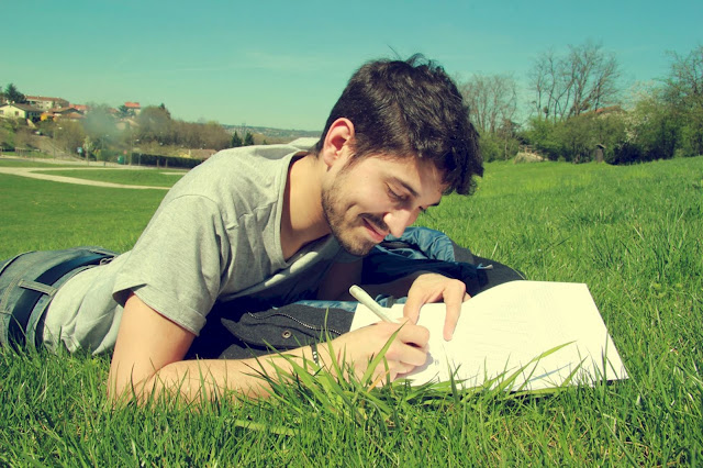Man writing on green grass field, Writing as Hobby - Image: Pixabay - Pexels